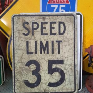 panneau routier americain de limitation de vitesse speed limit 35 cracked 76x61cm