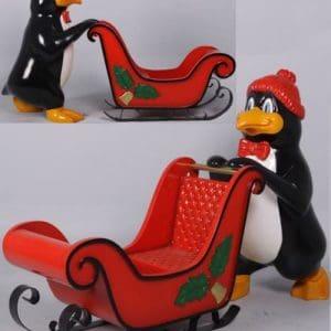 pingouin poussant traineau